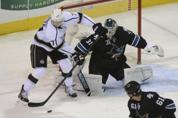 Apr 3, 2014; San Jose, CA, USA; Los Angeles Kings center Jeff Carter (77) controls the puck in front of San Jose Sharks goalie Antti Niemi (31) during the first period at SAP Center at San Jose. Mandatory Credit: Kyle Terada-USA TODAY Sports