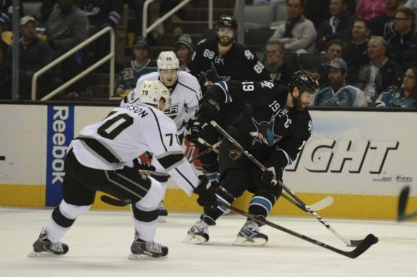 Apr 3, 2014; San Jose, CA, USA; San Jose Sharks center Joe Thornton (19) controls the puck against Los Angeles Kings left wing Tanner Pearson (70) during the second period at SAP Center at San Jose. Mandatory Credit: Kyle Terada-USA TODAY Sports