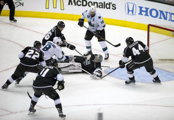 Apr 24, 2014; Los Angeles, CA, USA; Los Angeles Kings goalie Jonathan Quick (32) is unable to make a save as San Jose Sharks center Joe Pavelski (8) attempts a shot for a goal during the third period in game four of the first round of the 2014 Stanley Cup Playoffs at Staples Center. The Los Angeles Kings won 6-3. Mandatory Credit: Kelvin Kuo-USA TODAY Sports