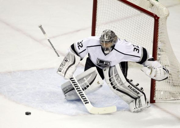 Apr 26, 2014; San Jose, CA, USA; Los Angeles Kings goalie Jonathan Quick (32) looks to stop the puck against the San Jose Sharks during the first period in game five of the first round of the 2014 Stanley Cup Playoffs at SAP Center at San Jose. Mandatory Credit: Cary Edmondson-USA TODAY Sports