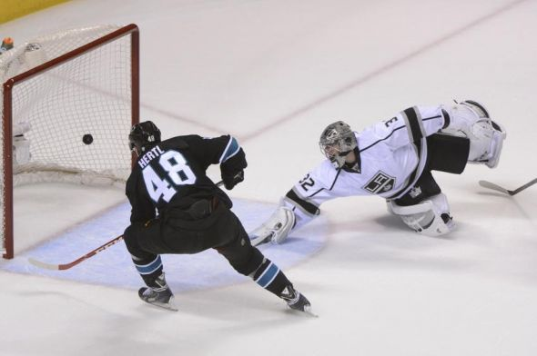 April 17, 2014; San Jose, CA, USA; San Jose Sharks center Tomas Hertl (48) scores a goal past Los Angeles Kings goalie Jonathan Quick (32) during the first period in game one of the first round of the 2014 Stanley Cup Playoffs at SAP Center at San Jose. Mandatory Credit: Kyle Terada-USA TODAY Sports