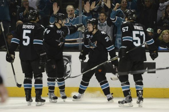 Apr 3, 2014; San Jose, CA, USA; San Jose Sharks center Logan Couture (39) is congratulated for scoring a goal against the Los Angeles Kings during the second period at SAP Center at San Jose. Mandatory Credit: Kyle Terada-USA TODAY Sports