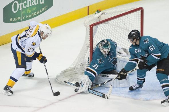 Apr 5, 2014; San Jose, CA, USA; San Jose Sharks goalie Antti Niemi (31) makes a save on a shot by Nashville Predators right wing Patric Hornqvist (27) during the third period at SAP Center at San Jose. The Nashville Predators defeated the San Jose Sharks 3-0. Mandatory Credit: Ed Szczepanski-USA TODAY Sports