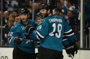 October 19, 2013; San Jose, CA, USA; San Jose Sharks center Patrick Marleau (12), center Joe Pavelski (8, center) and center Joe Thornton (19) celebrate after Pavelski scored a goal against the Calgary Flames during the second period at SAP Center at San Jose. The Sharks defeated the Flames 6-3. Mandatory Credit: Kyle Terada-USA TODAY Sports