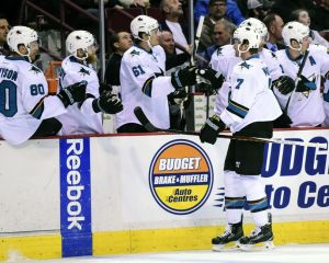 Sep 22, 2015; Vancouver, British Columbia, CAN; San Jose Sharks defenseman Paul Martin (7) celebrates his goal during the first period at Rogers Arena. Mandatory Credit: Anne-Marie Sorvin-USA TODAY Sports