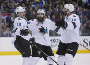Dec 17, 2015; Toronto, Ontario, CAN; San Jose Sharks defenceman Brent Burns (88) and forward Joe Thornton (19) celebrate a goal by forward Patrick Marleau (12) during the first period against the Toronto Maple Leafs at the Air Canada Centre. Mandatory Credit: John E. Sokolowski-USA TODAY Sports