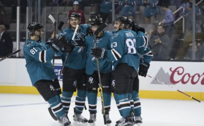 September 27, 2016; San Jose, CA, USA; San Jose Sharks forward Kevin Labanc (62) is congratulated for scoring the game-winning goal in overtime during a preseason hockey game against the Vancouver Canucks at SAP Center at San Jose. Mandatory Credit: Kyle Terada-USA TODAY Sports