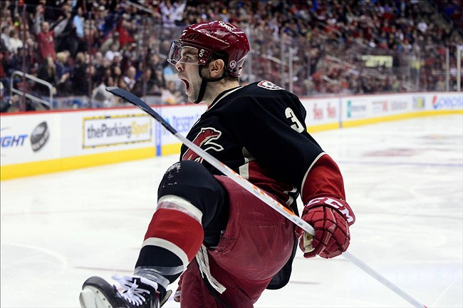 Feb. 18, 2013; Glendale, AZ, USA; Phoenix Coyotes defenseman Keith Yandle (3) celebrates after scoring a goal in the first period against the Calgary Flames at Jobing.com Arena. Matt Kartozian-USA TODAY Sports