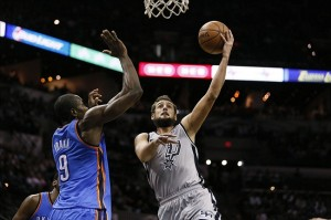 Dec 21, 2013; San Antonio, TX, USA; San Antonio Spurs forward Marco Belinelli (3) drives to the basket under pressure from Oklahoma City Thunder forward Serge Ibaka (9) during the second half at AT