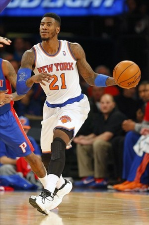 Jan 7, 2014; New York, NY, USA; New York Knicks shooting guard Iman Shumpert (21) handles the ball during the first half against the Detroit Pistons at Madison Square Garden. Mandatory Credit: Jim O