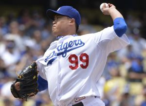 Apr 27, 2014; Los Angeles, CA, USA; Los Angeles Dodgers starting pitcher Hyun-Jin Ryu (99) throws in the first inning against the Colorado Rockies at Dodger Stadium. Mandatory Credit: Robert Hanashiro-USA TODAY Sports