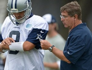 Jul 21, 2013; Oxnard, CA, USA; Dallas Cowboys offensive coordinator Bill Callahan (right) and quarterback Tony Romo (9) at training camp at the River Ridge Fields. Mandatory Credit: Kirby Lee-USA TODAY Sports