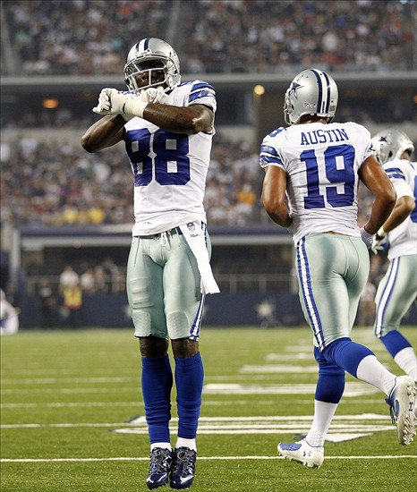 Aug 24, 2013; Arlington, TX, USA; Dallas Cowboys wide receiver Dez Bryant (88) celebrates scoring a touchdown a touchdown in the second quarter of the game against the Cincinnati Bengals at AT