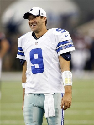 Aug 29, 2013; Arlington, TX, USA; Dallas Cowboys quarterback Tony Romo (9) smiles while on the field before the game against the Houston Texans at AT
