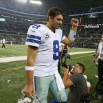 Sep 8, 2013; Arlington, TX, USA; Dallas Cowboys quarterback Tony Romo (9) pumps his fist on his way to the locker room after the game against the New York Giants at AT