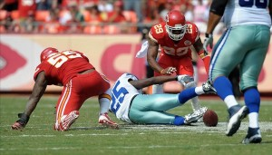 Sep 15, 2013; Kansas City, MO, USA; Dallas Cowboys running back Lance Dunbar (25) fumbles the ball as he is tackled by Kansas City Chiefs inside linebacker Akeem Jordan (55) during the second half at Arrowhead Stadium. The Chiefs won 17-16. Mandatory Credit: Denny Medley-USA TODAY Sports