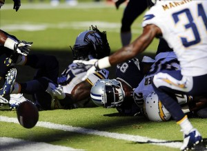 Sep 29, 2013; San Diego, CA, USA; Dallas Cowboys receiver Terrance Williams (83) fumbles into the end zone during the second half against the Dallas Cowboys at Qualcomm Stadium. The Chargers won 30-21. Mandatory Credit: Christopher Hanewinckel-USA TODAY Sports