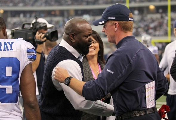 Nov 6, 2011; Arlington, TX, USA; Dallas Cowboys former running back Emmitt Smith greets head coach Jason Garrett during halftime from the game against the Seattle Seahawks at Cowboys Stadium. The Cowboys beat the Seahawks 23-13. Mandatory Credit: Matthew Emmons-USA TODAY Sports