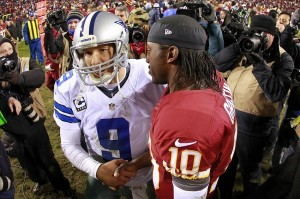 December 30, 2012; Landover, MD, USA; Washington Redskins quarterback Robert Griffin III (10) talks with Dallas Cowboys quarterback Tony Romo (9) after their game at FedEx Field. The Redskins won 28-18. Mandatory Credit: Geoff Burke-USA TODAY Sports