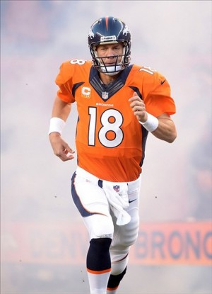 Sep 23, 2013; Denver, CO, USA; Denver Broncos quarterback Peyton Manning (18) runs onto the field before the game against the Oakland Raiders at Sports Authority Field at Mile High. The Broncos defeated the Raiders 37-21. Mandatory Credit: Kirby Lee-USA TODAY Sports