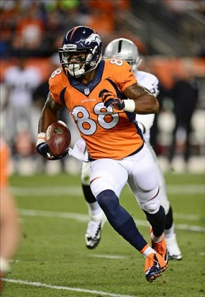 Sep 23, 2013; Denver, CO, USA; Denver Broncos wide receiver Demaryius Thomas (88) runs after a reception during the second quarter against the Oakland Raiders at Sports Authority Field at Mile High. The Broncos defeated the Raiders 37-21. Mandatory Credit: Ron Chenoy-USA TODAY Sports