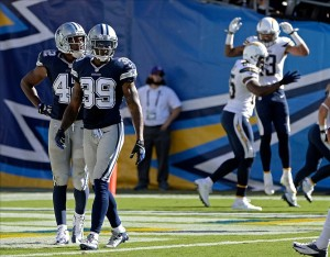 Sep 29, 2013; San Diego, CA, USA; Dallas Cowboys free safety Barry Church (42) and cornerback Brandon Carr (39) react as the San Diego Chargers celebrate a touchdown by Chargers tight end Antonio Gates at Qualcomm Stadium. Mandatory Credit: Robert Hanashiro-USA TODAY Sports