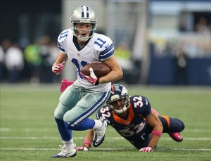 Oct 6, 2013; Arlington, TX, USA; Dallas Cowboys receiver Cole Beasley (11) runs after a reception against Denver Broncos cornerback Tony Carter (32) at AT