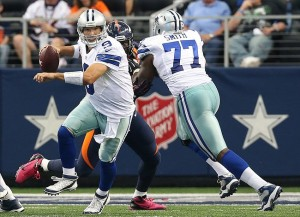 Oct 6, 2013; Arlington, TX, USA; Dallas Cowboys quarterback Tony Romo (9) scrambles in the second quarter against the Denver Broncos at AT