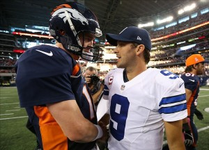Oct 6, 2013; Arlington, TX, USA; Denver Broncos quarterback Peyton Manning (18) meets with Dallas Cowboys quarterback Tony Romo (9) at the end of the game at AT