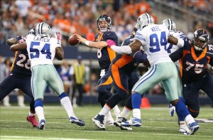 Oct 6, 2013; Arlington, TX, USA; Denver Broncos quarterback Peyton Manning (18) throws in the pocket against the Dallas Cowboys at AT