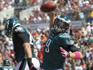 Oct 13, 2013; Tampa, FL, USA; Philadelphia Eagles quarterback Nick Foles (9) spikes the ball after scoring a touchdown during the first quarter against the Tampa Bay Buccaneers at Raymond James Stadium. Mandatory Credit: Kim Klement-USA TODAY Sports