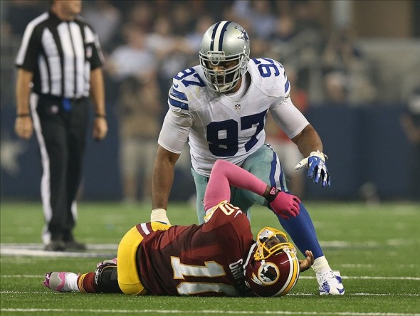 Oct 13, 2013; Arlington, TX, USA; Dallas Cowboys defensive tackle Jason Hatcher (97) sacks Washington Redskins quarterback Robert Griffin III in the second quarter at AT