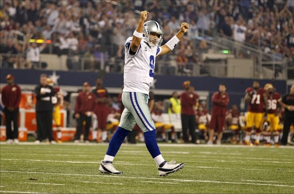 Oct 13, 2013; Arlington, TX, USA; Dallas Cowboys quarterback Tony Romo (9) celebrates a touchdown in the first quarter of the game Washington Redskins at AT