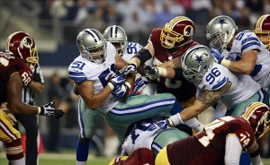 Oct 13, 2013; Arlington, TX, USA; Dallas Cowboys defensive end Kyle Wilber (51) recovers a fumble by Washington Redskins quarterback Robert Griffin III (not pictured) in the fourth quarter at AT