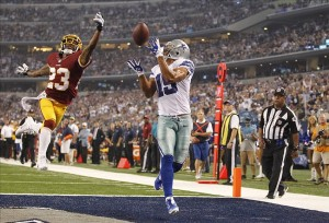 Oct 13, 2013; Arlington, TX, USA; Dallas Cowboys wide receiver Miles Austin (19) cannot catch a pass against Washington Redskins cornerback DeAngelo Hall (23) in the fourth quarter at AT