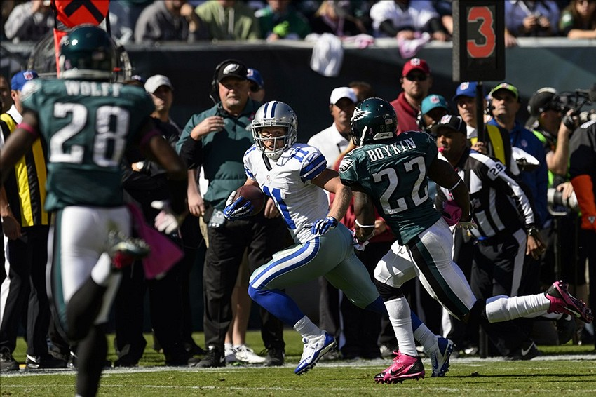 Oct 20, 2013; Philadelphia, PA, USA; Dallas Cowboys wide receiver Cole Beasley (11) is chased by Philadelphia Eagles cornerback Brandon Boykin (22) during the first quarter at Lincoln Financial Field. The Cowboys defeated the Eagles 17-3. Mandatory Credit: Howard Smith-USA TODAY Sports