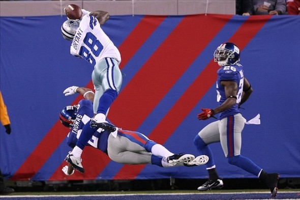 Nov 14 2010; East Rutherford, NJ, USA; Dallas Cowboys wide receiver Dez Bryant (88) catches the ball for a touchdown past New York Giants cornerback Terrell Thomas (bottom) and safety Antrel Rolle (26) during the first half at the New Meadowlands Stadium. Mandatory Credit: Alan Maglaque-US PRESSWIRE