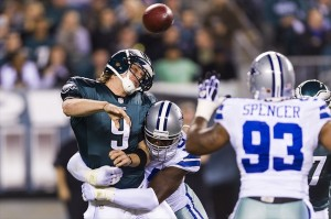 Nov 11, 2012; Philadelphia, PA, USA; Philadelphia Eagles quarterback Nick Foles (9) passes the ball as he is hit by Dallas Cowboys linebacker DeMarcus Ware (94) during the second quarter at Lincoln Financial Field. Mandatory Credit: Howard Smith-USA TODAY Sports