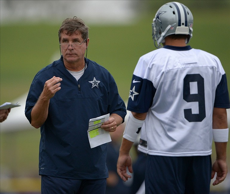 Jul 21, 2013; Oxnard, CA, USA; Dallas Cowboys offensive coordinator Bill Callahan (left) and quarterback Tony Romo (9) at training camp at the River Ridge Fields. Mandatory Credit: Kirby Lee-USA TODAY Sports
