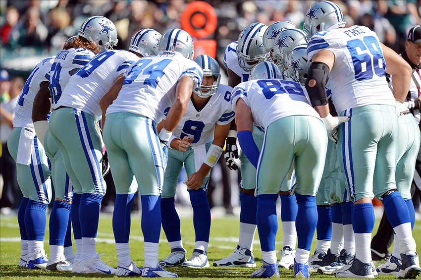 October 20, 2013; Philadelphia, PA, USA; Dallas Cowboys offense huddles around quarterback Tony Romo (9) against the Philadelphia Eagles during first quarter action at Lincoln Financial Field. Mandatory Credit: Jeffrey Pittenger-USA TODAY Sports