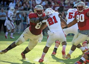 Oct 26, 2013; Tallahassee, FL, USA; Florida State Seminoles defensive tackle Timmy Jernigan (8) tackles North Carolina State Wolfpack running back Matt Dayes (21) during the second half at Doak Campbell Stadium. Mandatory Credit: Melina Vastola-USA TODAY Sports