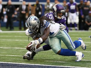Nov 3, 2013; Arlington, TX, USA; Dallas Cowboys receiver Dwayne Harris (17) dives for the game winning touchdown in the fourth quarter against Minnesota Vikings cornerback Marcus Sherels (35) at AT