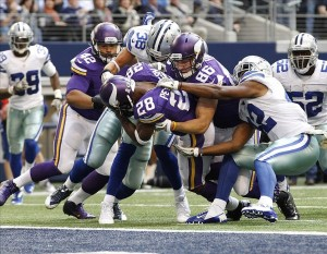 Nov 3, 2013; Arlington, TX, USA; Minnesota Vikings running back Adrian Peterson (28) scores a touchdown in the fourth quarter of the game against the Dallas Cowboys at AT