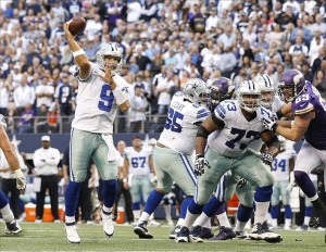 Nov 3, 2013; Arlington, TX, USA; Dallas Cowboys quarterback Tony Romo (9) throws a gaming winning touchdown pass in the fourth quarter of the game Minnesota Vikings at AT
