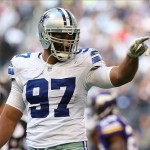 Nov 3, 2013; Arlington, TX, USA; Dallas Cowboys defensive tackle Jason Hatcher (97) celebrates after a tackle for a loss in the third quarter against the Minnesota Vikings at AT