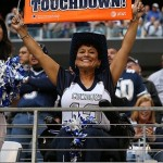 Nov 3, 2013; Arlington, TX, USA; Dallas Cowboys fan holds a touchdown sign up after the a score in the fourth quarter against the Minnesota Vikings at AT