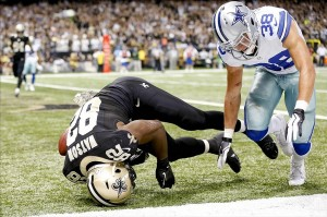 Nov 10, 2013; New Orleans, LA, USA; New Orleans Saints tight end Benjamin Watson (82) lands on his head in the endzone during the third quarter of a game against the Dallas Cowboys at Mercedes-Benz Superdome. Mandatory Credit: Derick E. Hingle-USA TODAY Sports