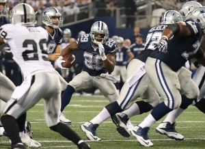 Nov 28, 2013; Arlington, TX, USA; Dallas Cowboys running back DeMarco Murray (29) runs with the ball for a second quarter touchdown against the Oakland Raiders during a NFL football game on Thanksgiving at AT
