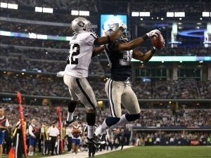 Nov 28, 2013; Arlington, TX, USA; Dallas Cowboys cornerback Brandon Carr (39) intercepts the ball in the end zone against Oakland Raiders receiver Jacoby Ford (12) in the fourth quarter during a NFL football game on Thanksgiving at AT
