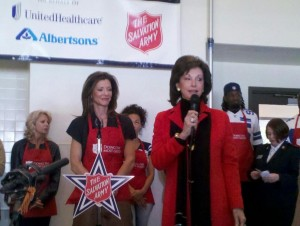 Gene Jones (front) and Charlotte Jones Anderson (background) thank the Dallas Cowboys and its partnerships for supporting the Salvation Army's annual outreach event -- Jordan Ross